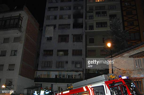 Firemen check the area after a fire erupted at the Hotel Normandy in Andorra La Vella early on February 24 2010 Two men a Spaniard and a Brazilian...
