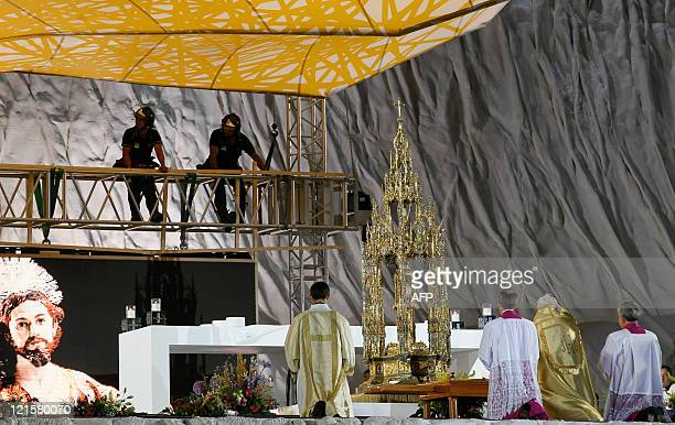 Firemen check the stage while Pope Benedict XVI leds a Prayer Vigil at the Cuatro Vientos air base in Madrid on August 20 2011 during the World Youth...