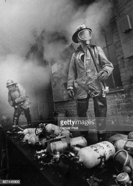 Firemen Come Out For Oxygen Two firemen come out of the burning basement of the First National Bank of Denver's purchasing supply department 1742...