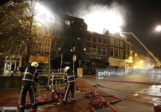 Firemen extinguish a fire in the centre of Leeuwarden in Northern Netherlands on October 20 2013 The fire caused one death and destroyed several...