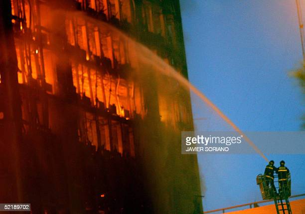 Firemen fight a fire at the Windsor building in downtown Madrid 13 February 2005 Squadrons of firefighters were battling a blaze early Sunday which...