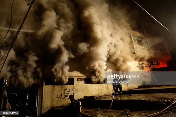 Firemen fight a fire in a building in the Lebanese capital Beirut on November 9 after a warehouse housed in the residential building caught fire. No...