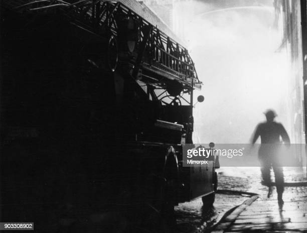 Firemen fighting fires at Britannia Row, Clerkenwell, London. The air raid was part of the Luftwaffe's Operation Steinbock, known in the UK as the...