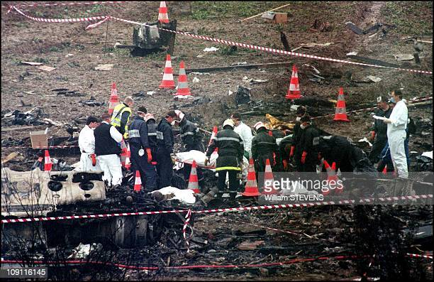Firemen Gathering The Bodies Of Crash Concorde Passengers On July 26Th 2000 In Gonesse France