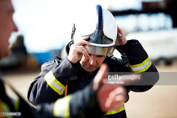 Firemen in discussion in training centre, Darlington, UK