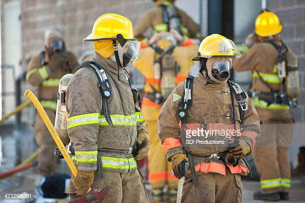 Firemen in Full Gear Outside Building