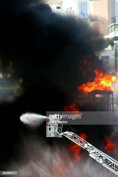 Firemen in protective suits try to put out fire after a simulated chemical hazard explosion during an antiterror drill on September 12 2005 in...