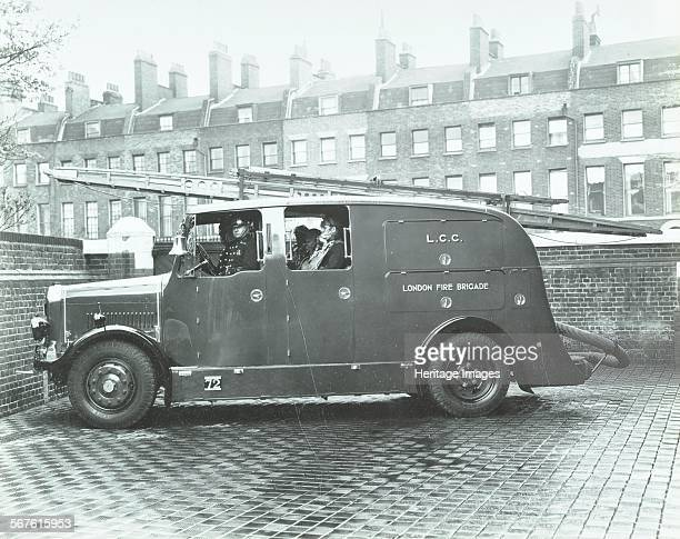 Firemen inside a fire engine Kingsland Road Fire Station London 1935 Streamlined fire escape vehicle with crew in breathing apparatus
