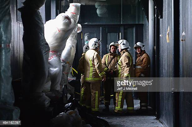 Firemen inside the Glasgow Art School as specialist removers continue the retrieval of student art work from the building on May 28 2014 in Glasgow...