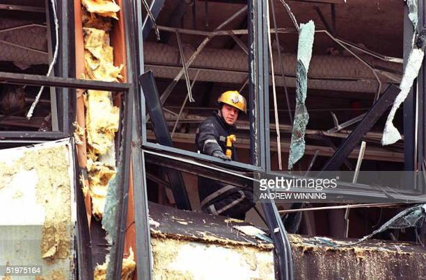 A firemen looks on 11 February from one of the buildings devastated by 09 February's IRA bombing in London's Dockland's area Two people were found...