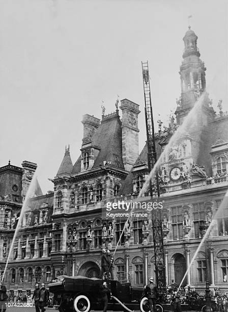 Firemen Manoeuvre In Front Of The City Hall In Paris On April 30Th 1933