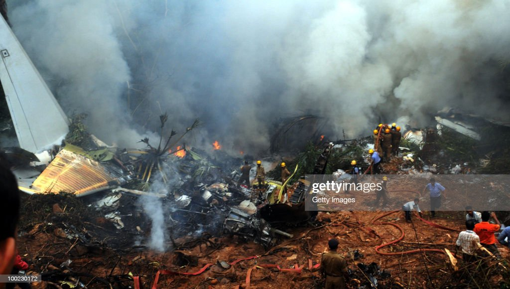 Firemen, para-military personnel and helpers at the site of the aircrash, on May 22, 2010 in Mangalore. An Air India Express Boeing 737-800 series aircraft overshot the runway on arrival and crashed into a forest. Airline officials say 8 people have been rescued while nearly 160 others are feared dead.