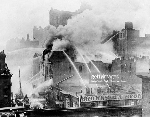 Firemen putting out fire at Webster Hall, the famous landmark at 117 E. 11th Street. 28 hoses were used before the flames in the building, famous in...