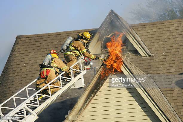 firemen putting out fire - burning stock pictures, royalty-free photos & images