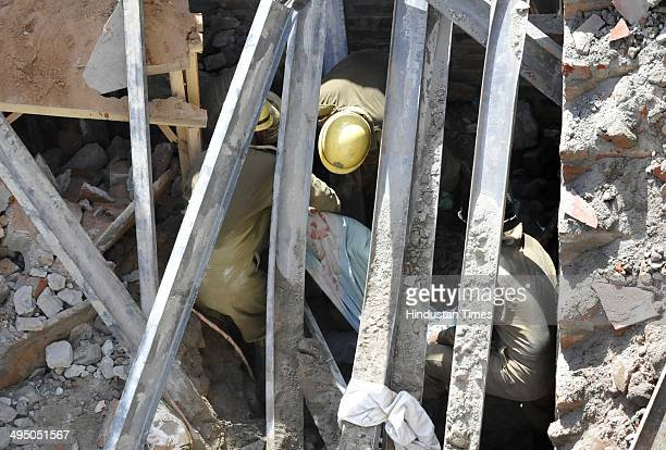Firemen removing the debries and taking out people from the debries those trapped at a underconstruction building at Gali Barni Sadar Bazar on June 1...