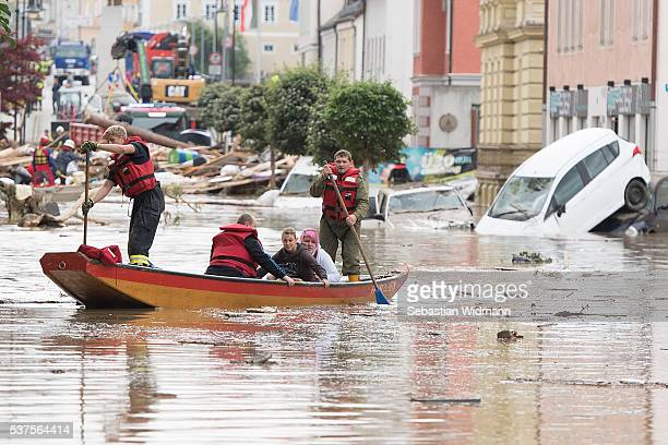 Firemen rescue two women with their boat following heavy floods the day before on June 2 2016 in Simbach am Inn Germany Flash floods from the swollen...