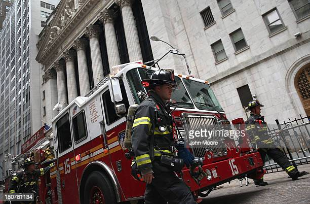 Firemen respond to a false alarm outside the New York Stock Exchange on Wall Street on September 16 2013 in New York City Five years after the...
