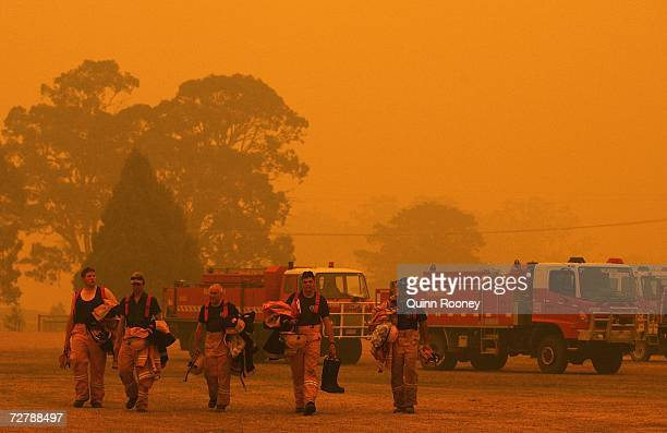 Firemen return to Briagolong base camp after battling bushfires on December 10 2006 in Melbourne Australia Thirtyseven bushfires thought to have been...