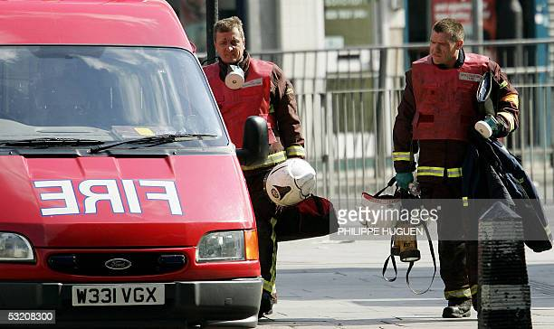 Firemen return to their vehicle outside Kings Cross Station in London after a bomb exploded on a subway train 07 July 2005 Explosions ripped through...