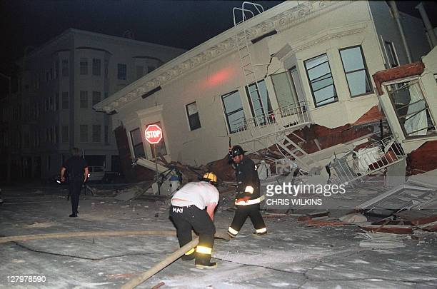 Firemen search for occupants in a heavily-damaged building in the Marina District of San Francisco, one of the areas hardest hit in the city by an...