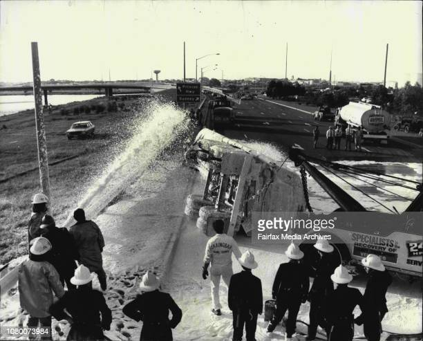 Firemen sprayed foam over a petrol tanker which overturned at Sydney Airport this afternoon April 16 1974