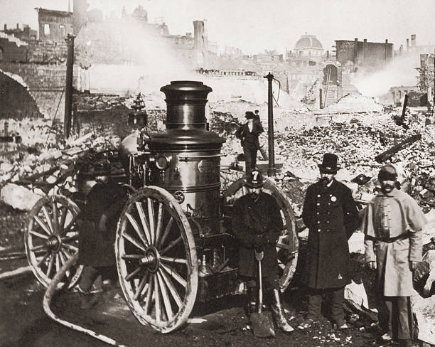 Firemen stand amidst the rubble after the Great Boston...