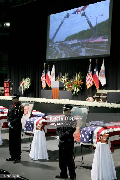 Firemen stand watch over caskets at the memorial service for the victims of the West Texas fertilizer plant explosion at Baylor University on April...
