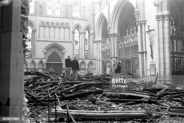 Firemen survey the fire damage to the South Transept of York Minster The South Transept was seriously damaged but after fighting the blaze for more...