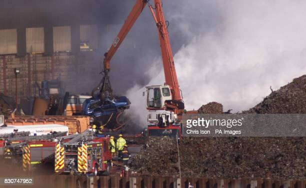 Firemen tackling a blaze in Jordan's Scrap Yard at North Quay Newhaven East Sussex where at least 2000 scrap cars were burning out of control Fire...