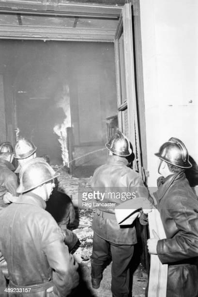 Firemen tackling a burning building during the riots France 25th May 1968
