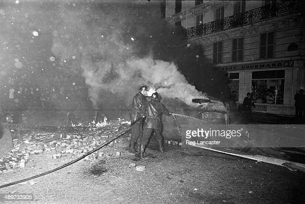 Firemen tackling blazes on rubble strewn streets of the Paris Latin Quarter during the riots France 25th May 1968
