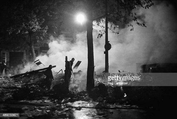 Firemen tackling street fires in the Paris Latin Quarter during the riots France 25th May 1968
