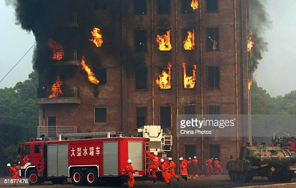 Firemen take part in an antiterror drill at a training base December 18 2004 in Foshan China China has launched large campaigns in the police system...