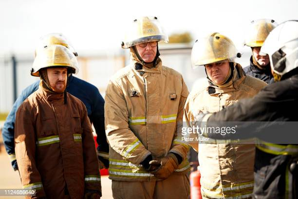 firemen training, firemen listening to supervisor at training facility - international firefighters day stock pictures, royalty-free photos & images