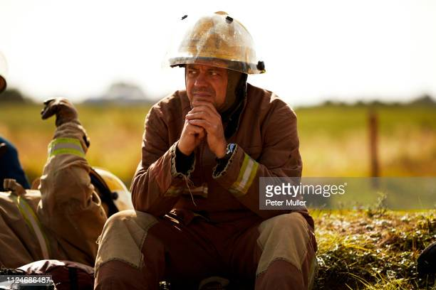 firemen training, firemen taking a break at training facility - international firefighters day stock pictures, royalty-free photos & images