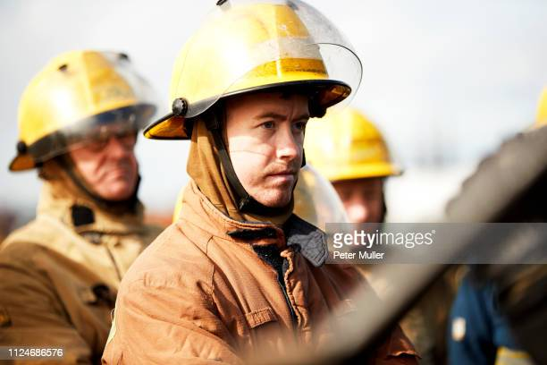 firemen training, small group of firemen listening to instructions - international firefighters day stock pictures, royalty-free photos & images