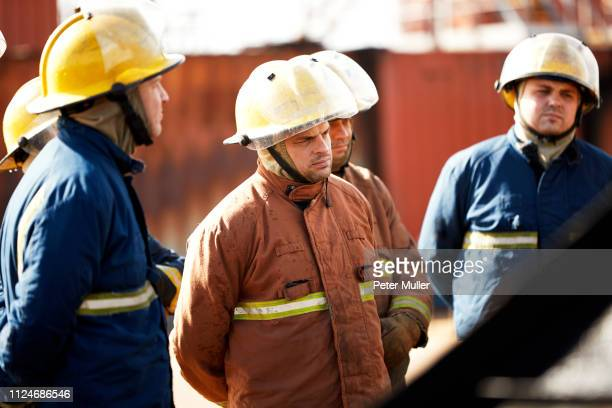 firemen training, team of firemen listening to supervisor at training facility - international firefighters day stock pictures, royalty-free photos & images