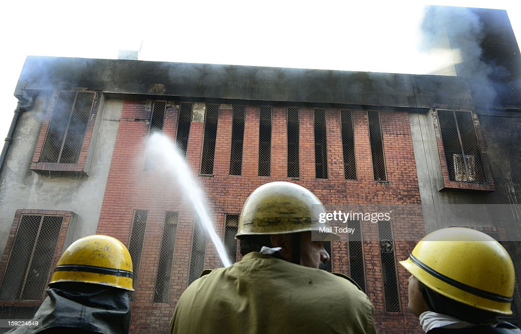 Firemen trying to douse the fire which broke out in a godown at Tuglakabad in New Delhi on Wednesday.