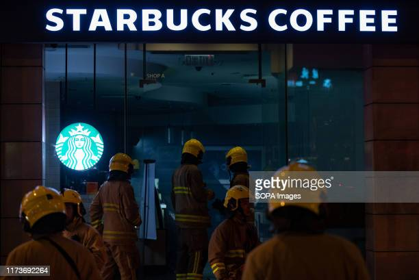 Firemen walk inside a Starbucks Coffee shop that was damaged by the prodemocratic protesters during a demonstration in Hong Kong Night of violence...
