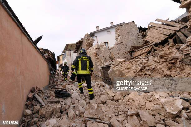 Firemen walks on the rubble in the devastated small village of Onna on April 12 epicentre of the April 6 earthquake that stroke the Abruzzo region....