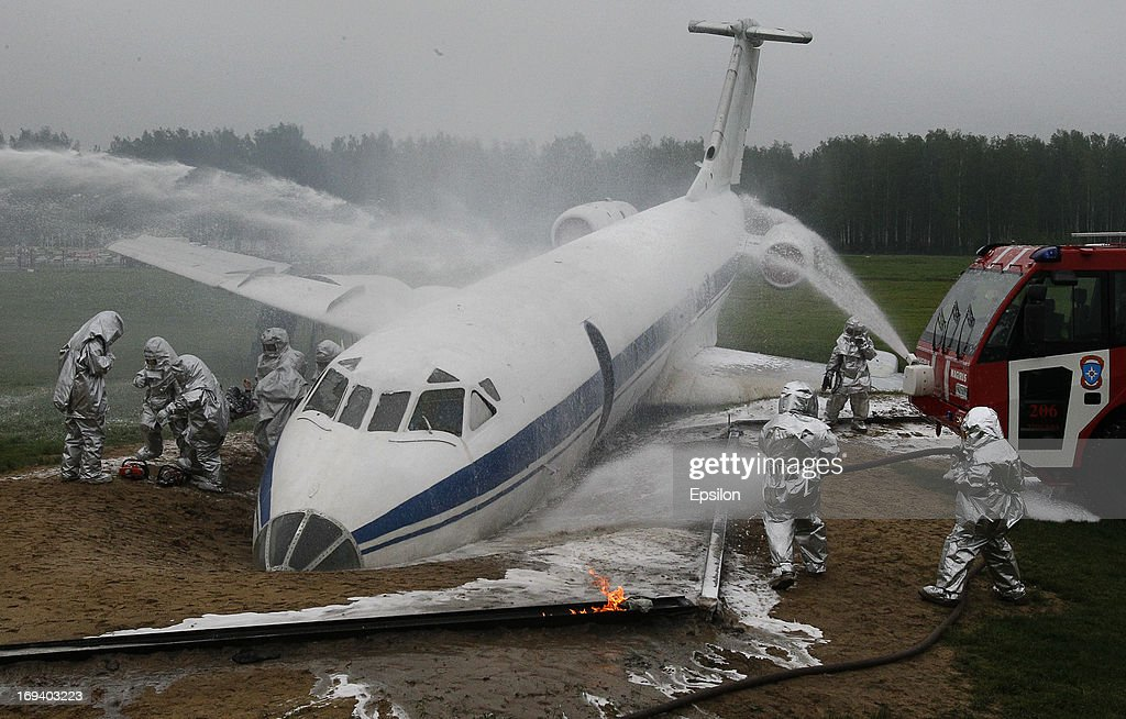Firemen wear protective clothing as they extinguish flames of a simulated plane crash during training exercises by the Russian Emergency Situations Ministry, at their Rescue Training Centre on May 24, 2013 in Noginsk, outside Moscow, Russia.