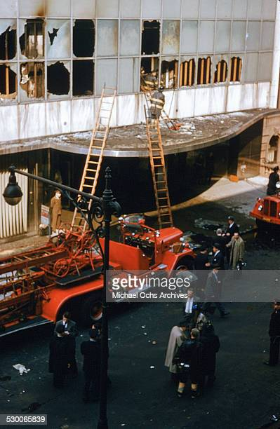 APRIL 151958 Firemen with ladders assess the damage after a fire broke out on the second floor of the Museum of Modern Art in New York NY