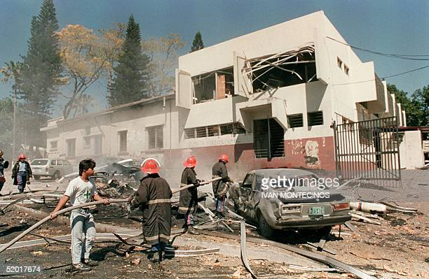 Firemen with the aid of civilians fight a fire caused by bazooka fire and explosives at the headquarters of the joint Chiefs of Staff of the Armed...