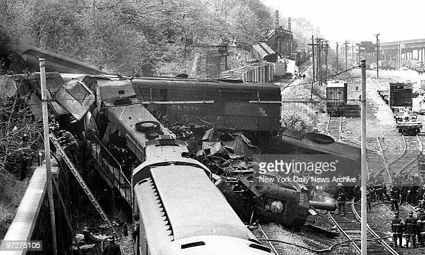 Firemen work amid wreckage after two freight trains operating on a single track and traveling toward each other at a 40 mileanhour clip collided in...