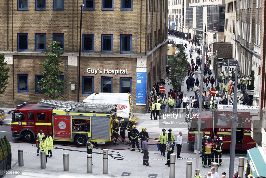 Firemen work in the area as people evacuate The Shard on June 5, 2014 in London, England. The Shard, London's tallest building standing at 310 meters high, was surrounded by fire brigade who evacuated 900 people after smoke was reported in the basement.