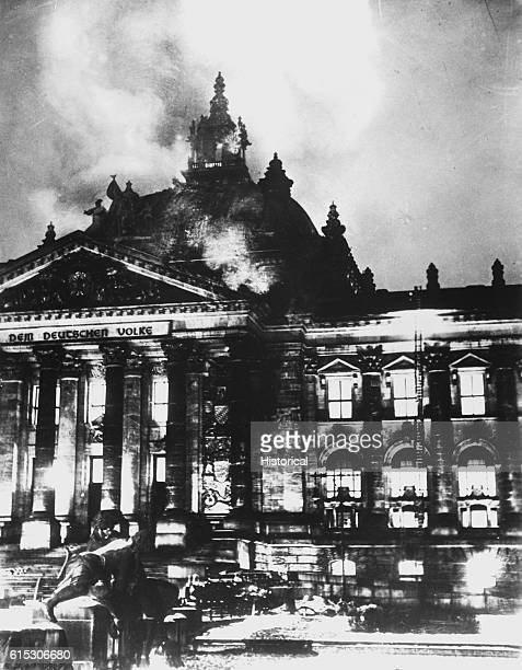 Firemen work on the burning Reichstag Building in February 1933 after fire broke out simultaneously at 20 places This enabled Hitler to seize power...