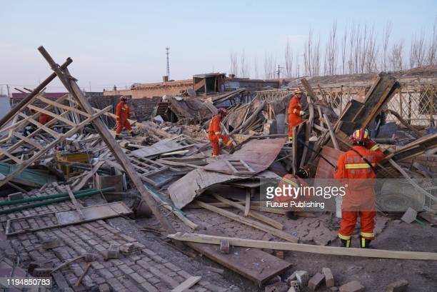 PAYZAWAT CHINA JANUARY 20 2020 Firemen work on the collapsed houses after a 64degree earthquake in Payzawat in northwest China's Xinjiang Uygur...