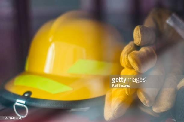 firemen's gear - firefighter's helmet stock photos and pictures