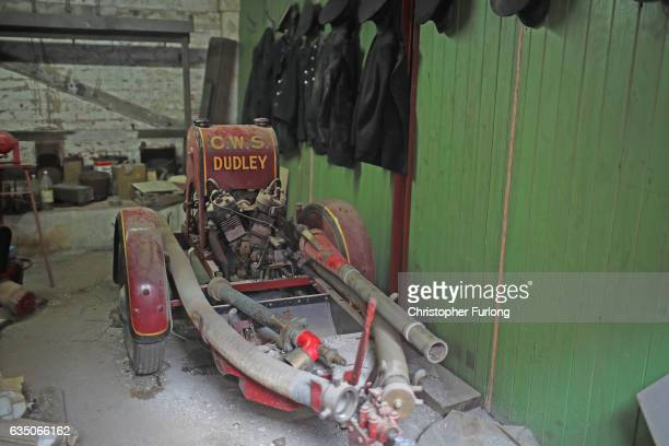 Firemen's uniforms hang on coat pegs in the hidden fire station of a Black Country factory on February 13 2017 in Dudley England A fire station that...