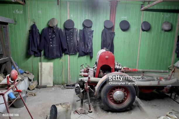 Firemen's uniforms hang on coat pegs in the hiden fire station of a Black Country factory on February 13 2017 in Dudley England A fire station that...